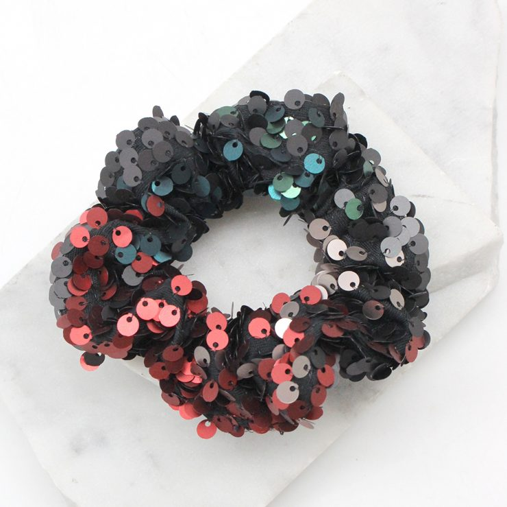 A photo of the Multi Color Sequin Scrunchie product