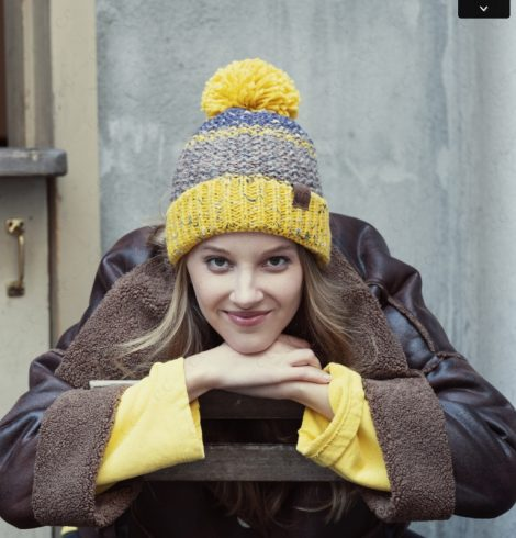 A photo of the Mustard and Blue Pom Pom Hat product