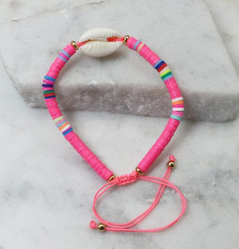A photo of the Cowrie Shell Adjustable Bracelet In Pink product