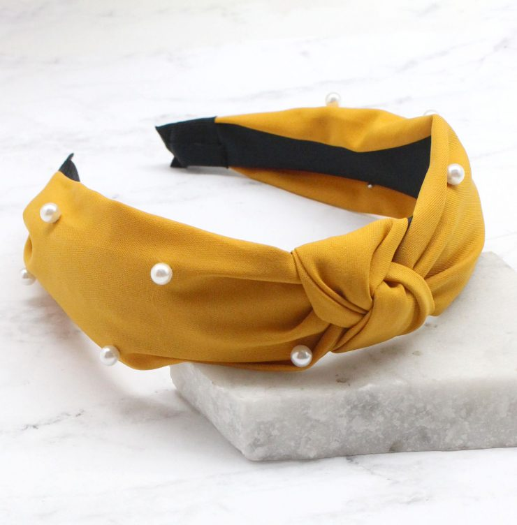 A photo of the Pearl Knot Headband in Nude product