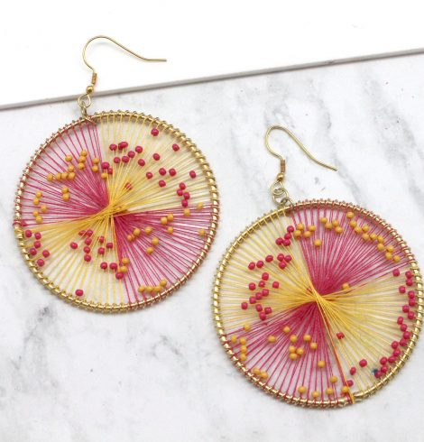A photo of the Pink Lemonade Earrings product