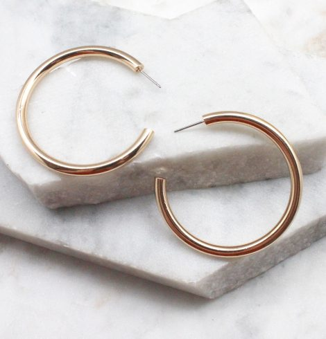 A photo of the Plain Gold Hoops product