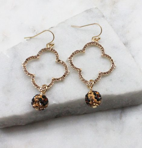 A photo of the Rhinestone Clover Earrings In Leopard product
