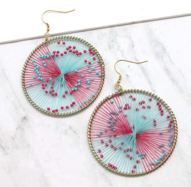 A photo of the Strawberry Earrings product