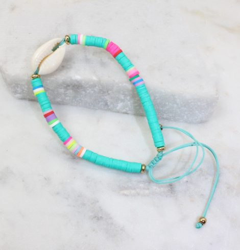 A photo of the Cowrie Shell Adjustable Bracelet In Turquoise product