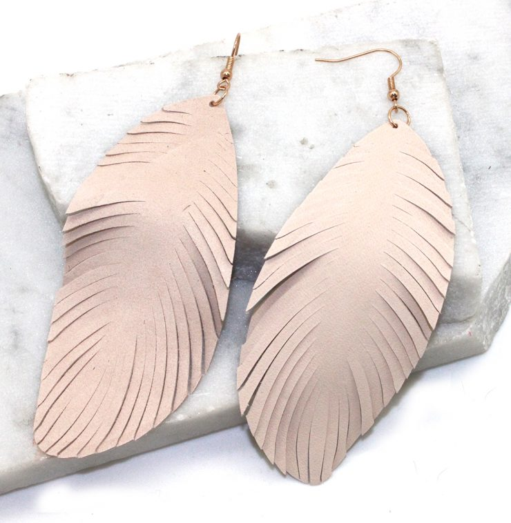 A photo of the Large Feather Earrings product