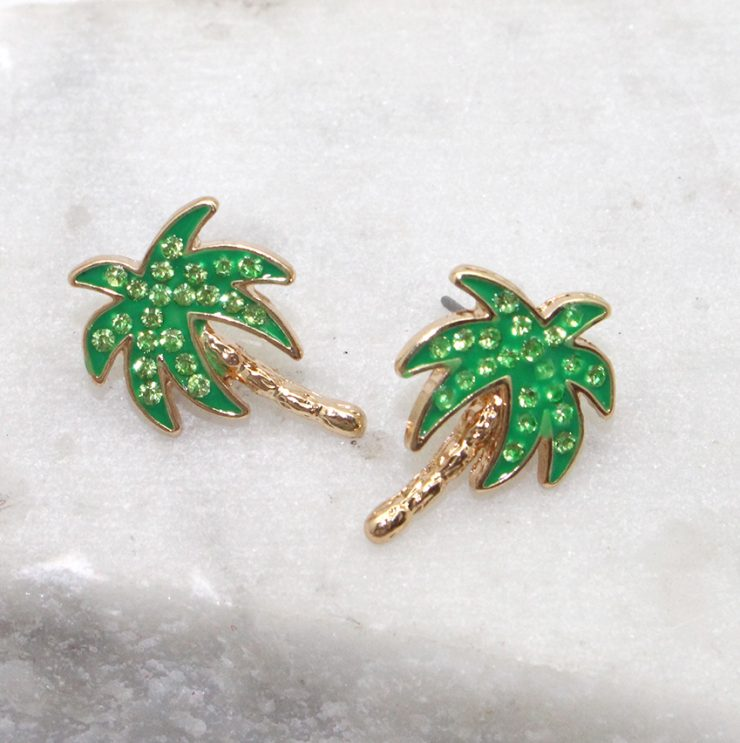A photo of the Palm Stud Earrings product