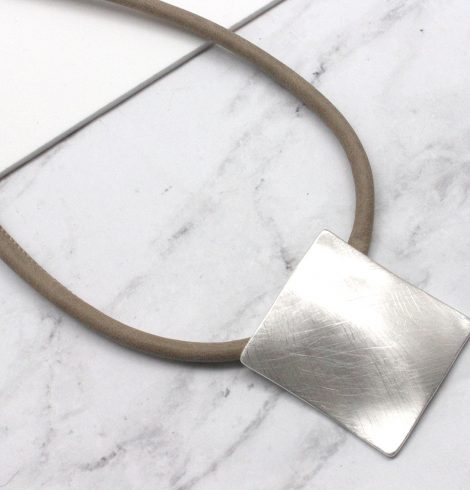A photo of the Matte Square Necklace product