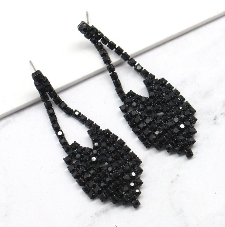 A photo of the Reina Earrings in Black product