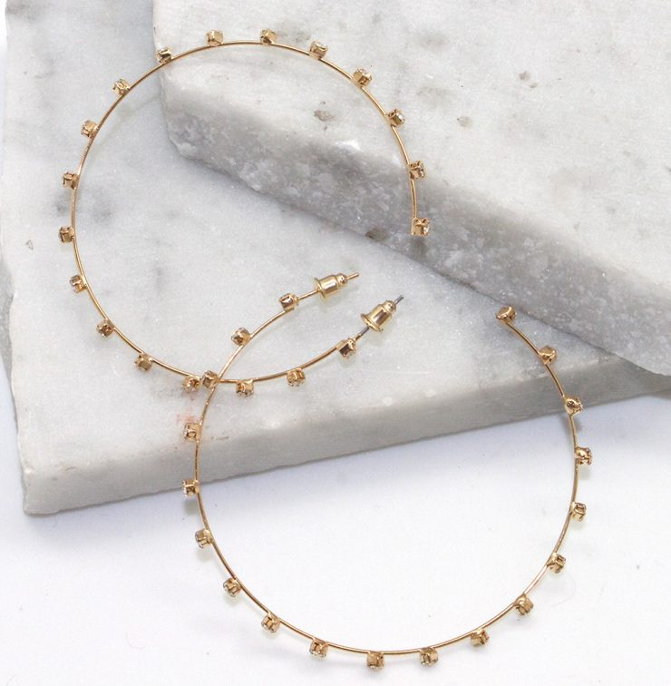 A photo of the Sparkle in the Sky Hoops in Gold product
