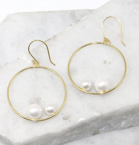 A photo of the Double Pearl Hoop Earrings product