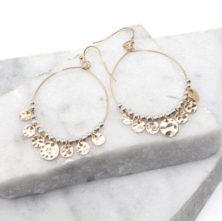 A photo of the Jingle Hoop Earrings in Two Tone product
