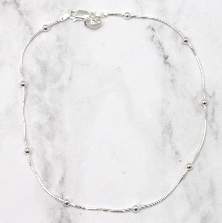 A photo of the Little Bead Anklet product