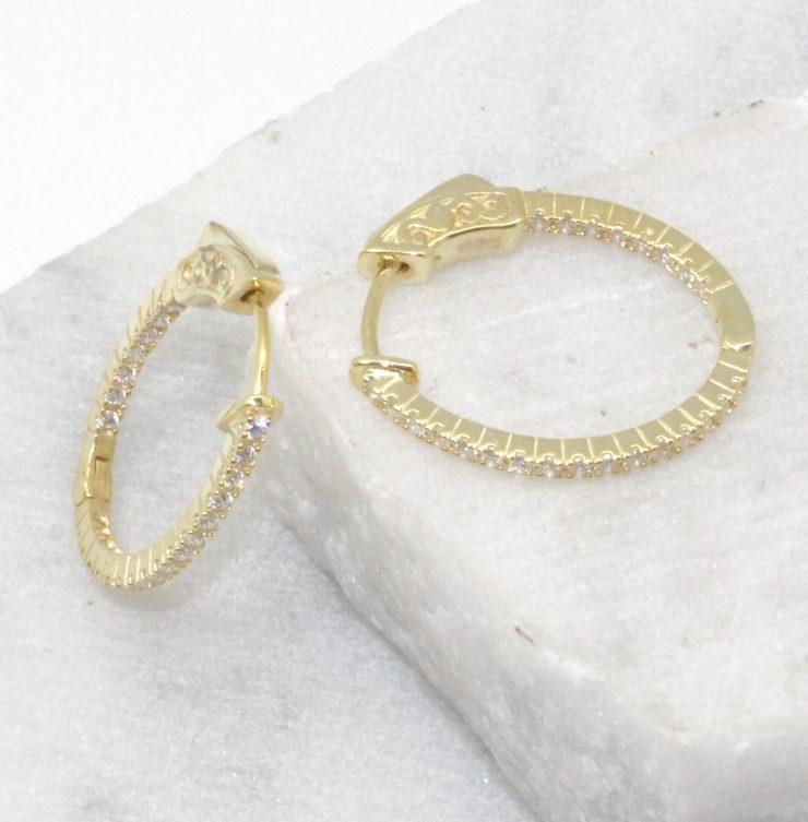 A photo of the Rhinestone Oval Hoop Earrings product