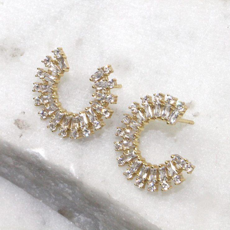 A photo of the Rhinestone Rim Earrings product