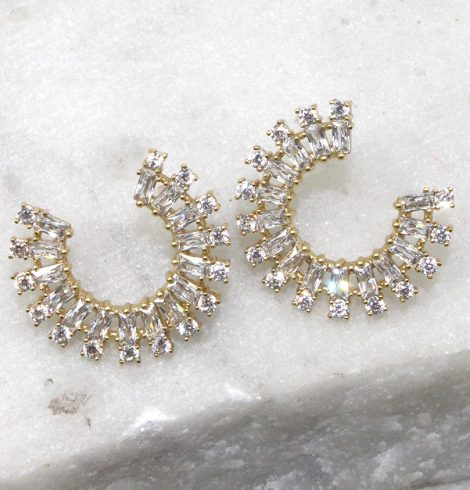 A photo of the Rhinestone Rim Earrings product