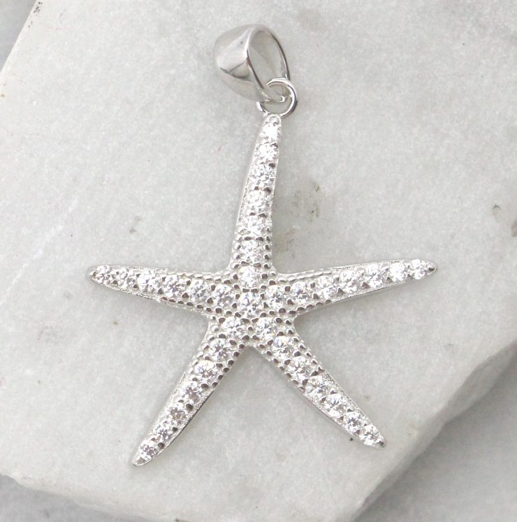 A photo of the The Sparkly Starfish Pendant product