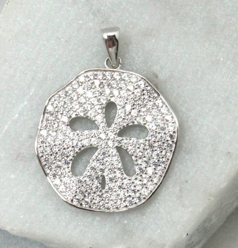A photo of the Wavy Sand Dollar Pendant product