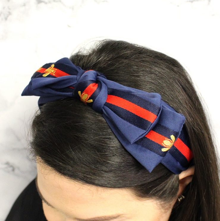 A photo of the Bee Bow Headband product