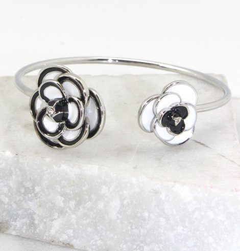 A photo of the Black and White Rose Cuff Bracelet product