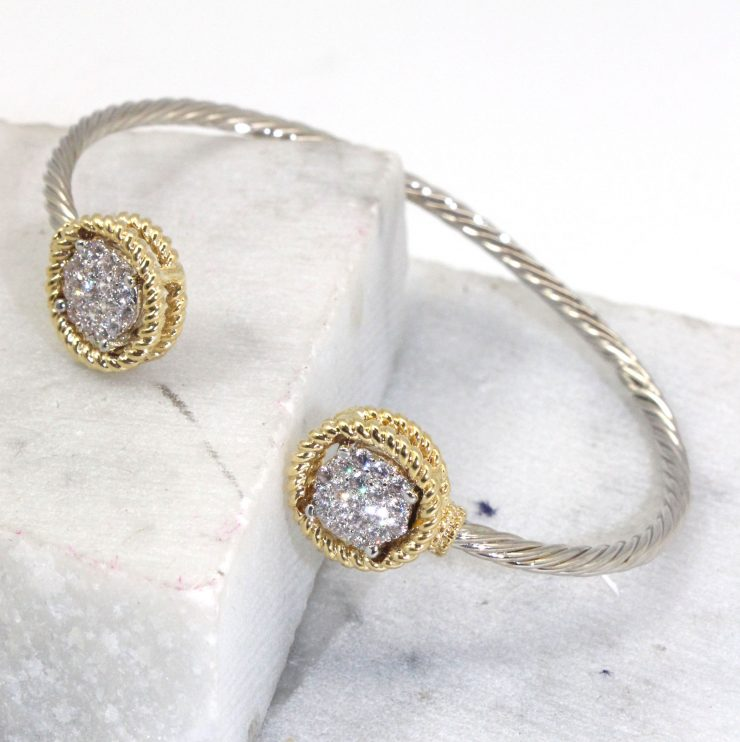 A photo of the Rhinestone Buttons Bracelet in Two Tone product