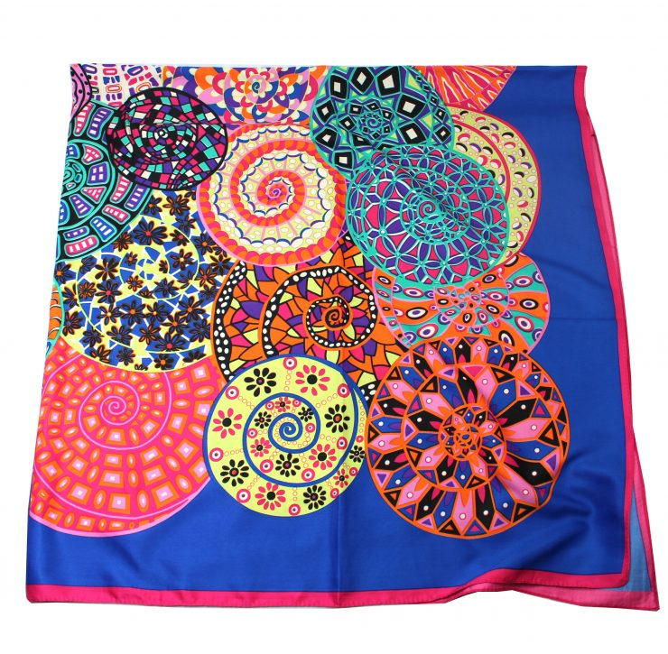 A photo of the Colorful Pinwheels Scarf product