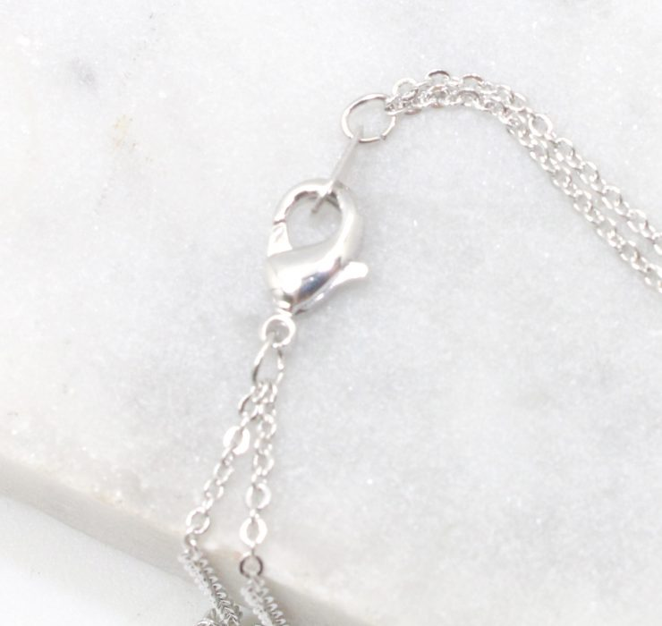 A photo of the Double the Love Necklace product