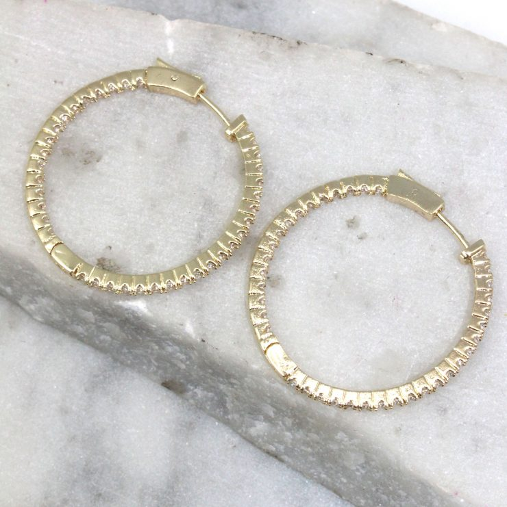 A photo of the Glammed Hoop Earrings product