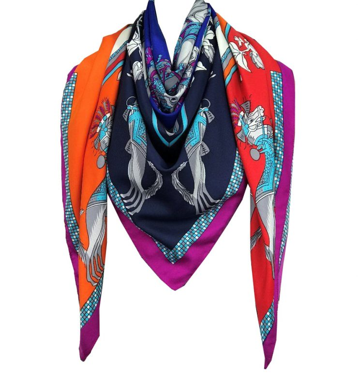 A photo of the Horse and Tassels Scarf product