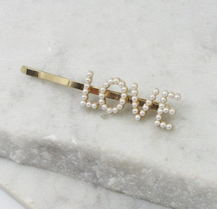A photo of the Love Pearl Hair Pin product