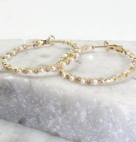 A photo of the Pearl Hoop Earrings product