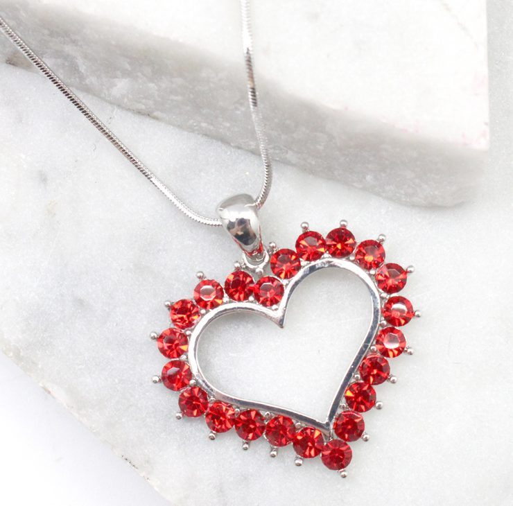 A photo of the Rhinestone Heart Necklace product