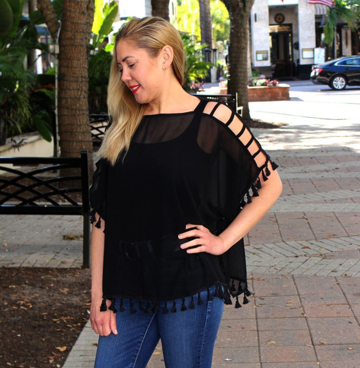 A photo of the Sheer Tassel Cover Up Blouse product