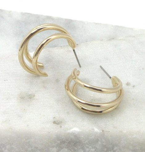 A photo of the Triple Threat Round Hoop Earrings product