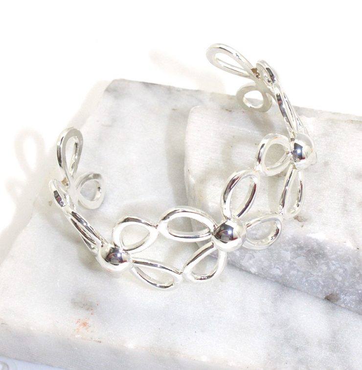 A photo of the Daisy Cuff Bracelet product