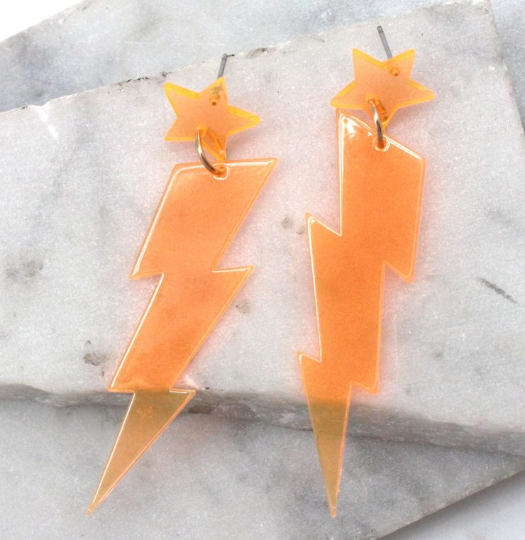 A photo of the Lighting Lucite Neon Earrings product