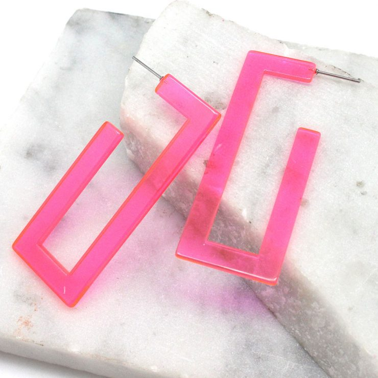 A photo of the Neon Lucite Rectangle Earrings product