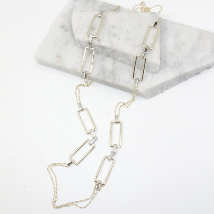 A photo of the Rectangle Link Long Necklace product