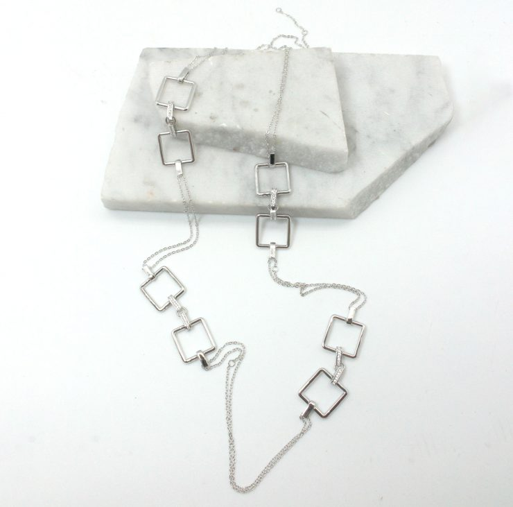 A photo of the Square Link Long Necklace product