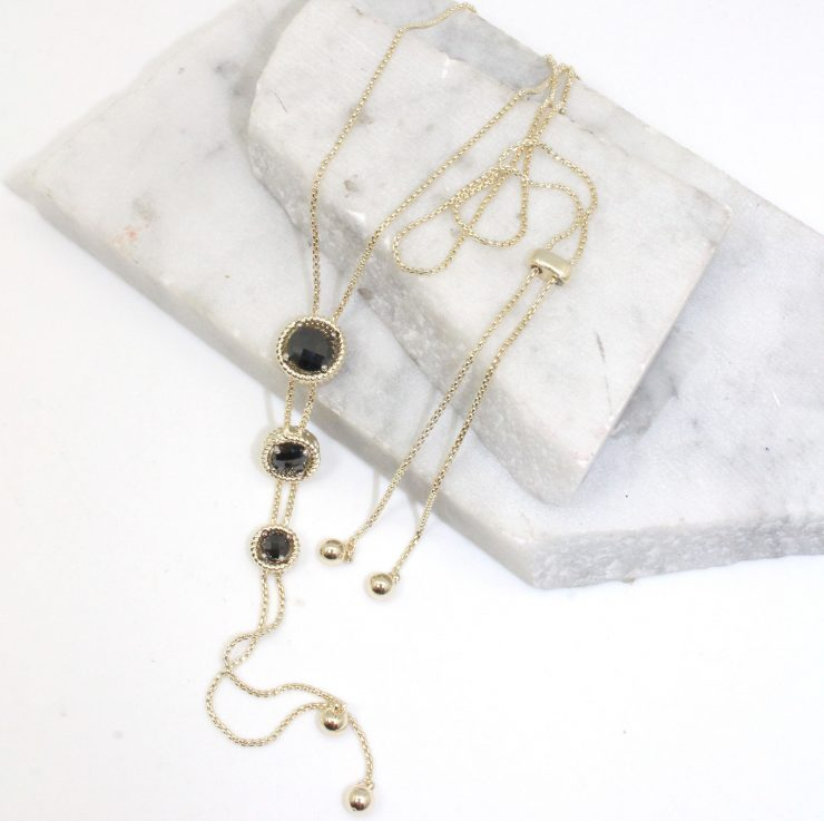 A photo of the Triple Pendant Necklace product