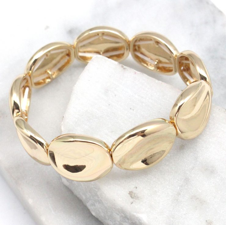 A photo of the Turn it Up Bracelet in Gold product