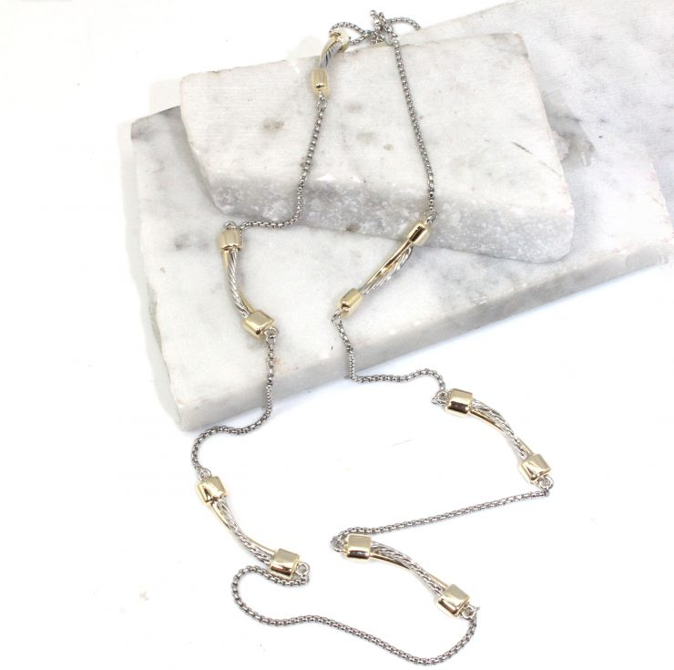 A photo of the Twisted Bars Long Necklace product