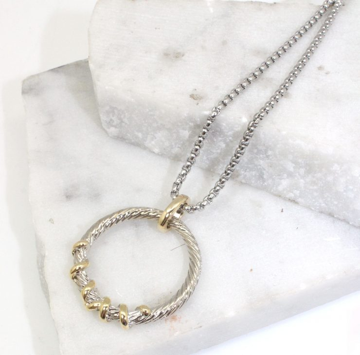 A photo of the Scribble Necklace product