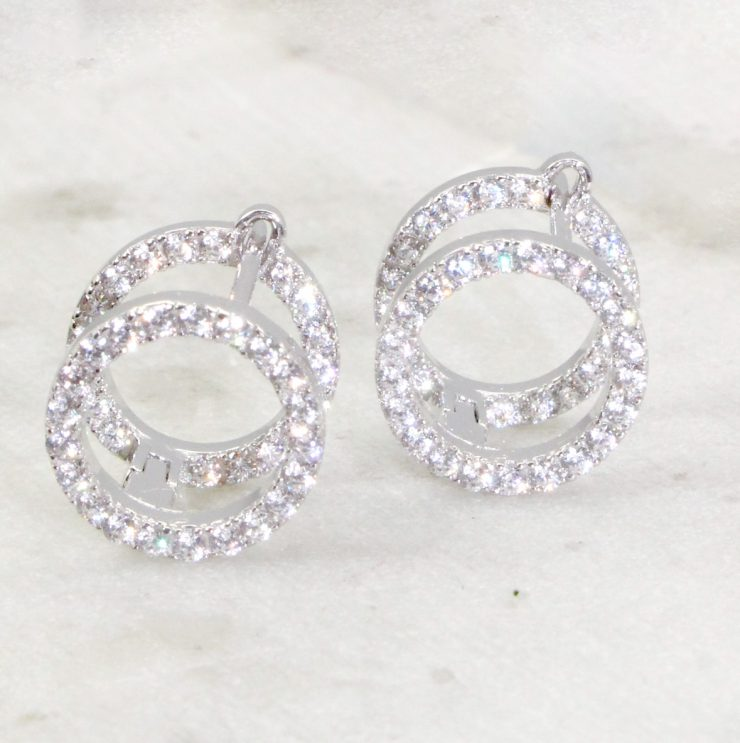 A photo of the Barrel Hoop Earrings product