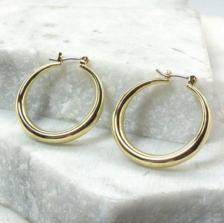 A photo of the Claudette Hoop Earrings product