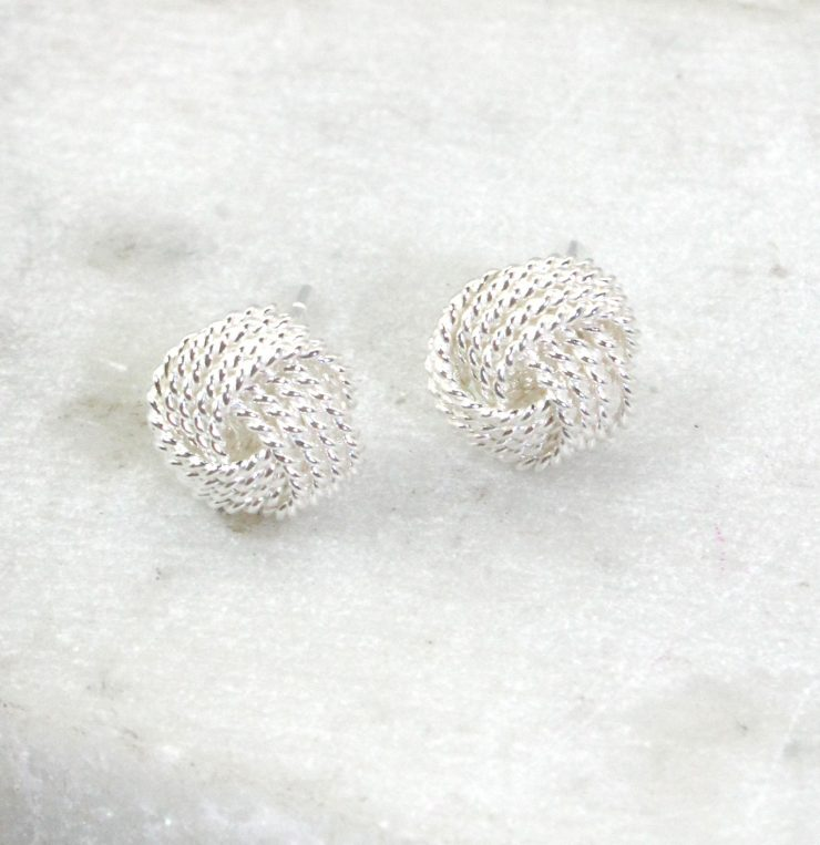 A photo of the Matte Love Knot Earrings product