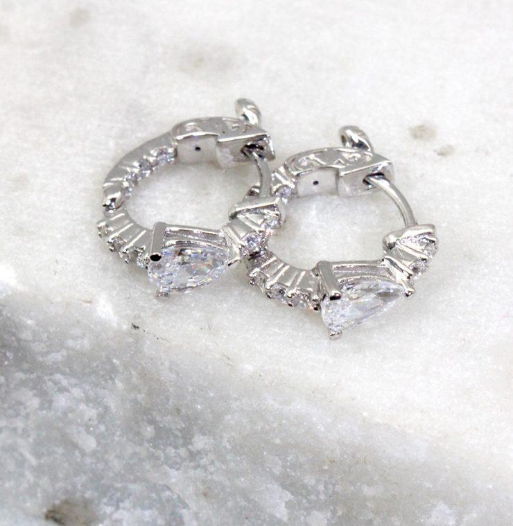 A photo of the Pear Rhinestone Huggie Hoop Earrings product