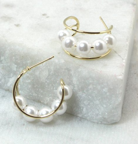 A photo of the Pearl Hooplette Earrings product