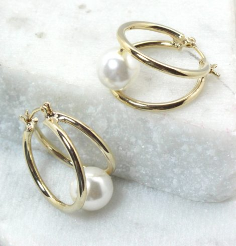 A photo of the Pearlina Hoop Earrings product