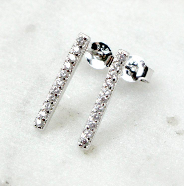A photo of the Rhinestone Bar Earrings product